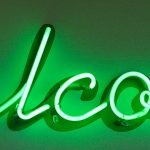 "Neon green ""Welcome"" sign"