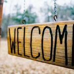 "Wooden sign reading ""Welcome"""