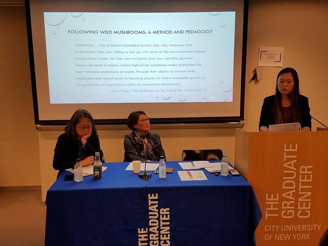 Frances Tran speaking at podium