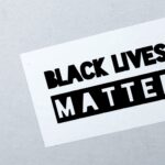 """Black and white stylized text reading """"Black Lives Matter"""""""