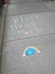 """""""Black lives Matter"""" written with sidewalk chalk"""
